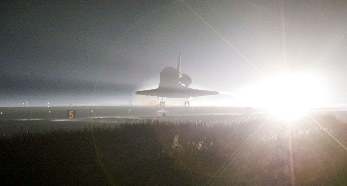 Space shuttle Atlantis lands at NASA's Kennedy Space Center in Florida for the final time, on July 21, 2011.