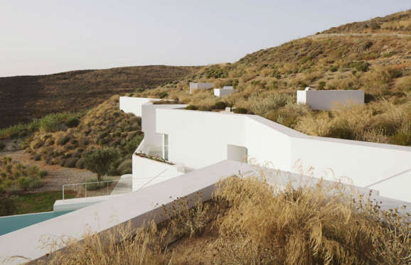 "Located on the island of Antiparos, Greece, Ktima House was based on the idea of using the existing site walls to create ""two dissimulated house elevations""."