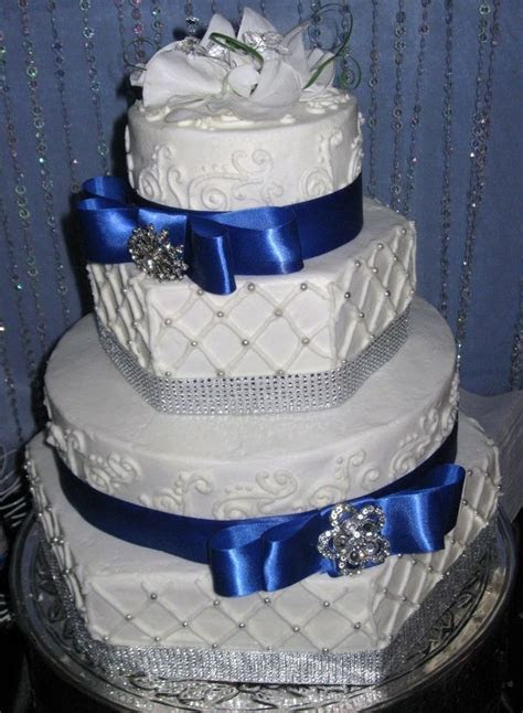 Hexagon and round cakes with rhinestone accents and satin