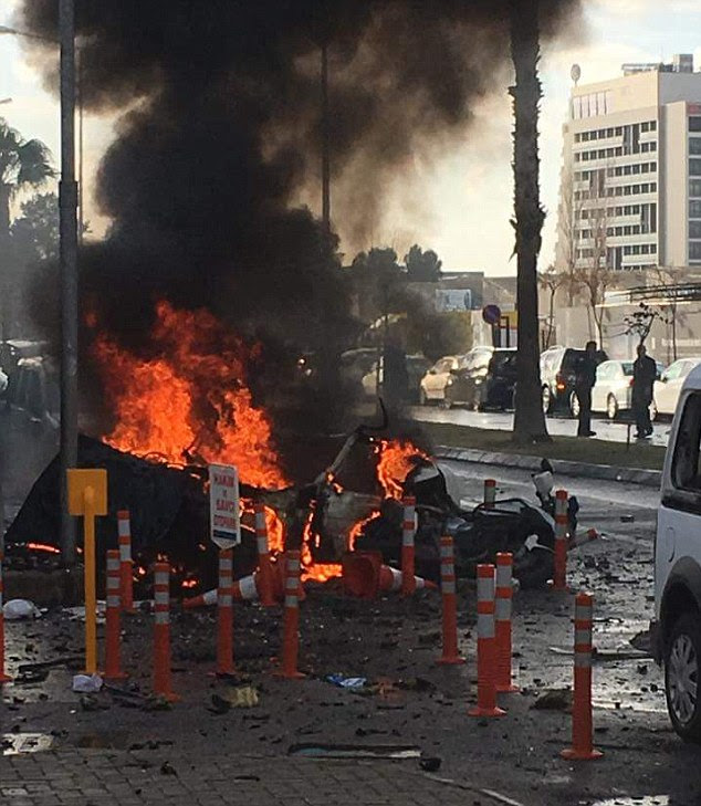 A car could be seen engulfed in flames moments after the blast, which killed a police officer and a courthouse worker