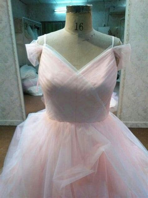 Blush colored plus size wedding dresses by Darius