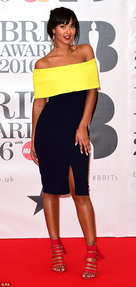 Star on the rise: TV and radio presenter Maya Jama, 21, oozed glam coolness in a figure-hugging black dress with a striking neon yellow band across the top, allowing her to flash her toned shoulders