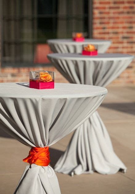Simple outdoor cocktail tables. pink orange gray wedding