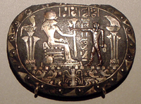 Part of a menat necklace said to depict Hariesis (Horus) extending a sistrum in front of the goddess Sekhmet