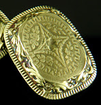 Elegantly engraved gold cufflinks. (J9450)