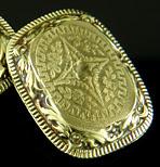 Elegantly engraved gold cufflinks. (J9450)