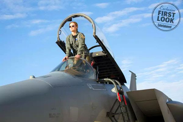 Carol Danvers strikes a pose from the cockpit of an F-15 Eagle fighter jet in CAPTAIN MARVEL.