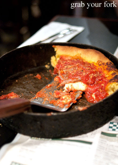 Cheese and sausage deep dish pizza Gino's East Pizzeria Chicago deep pan pizza Illinois