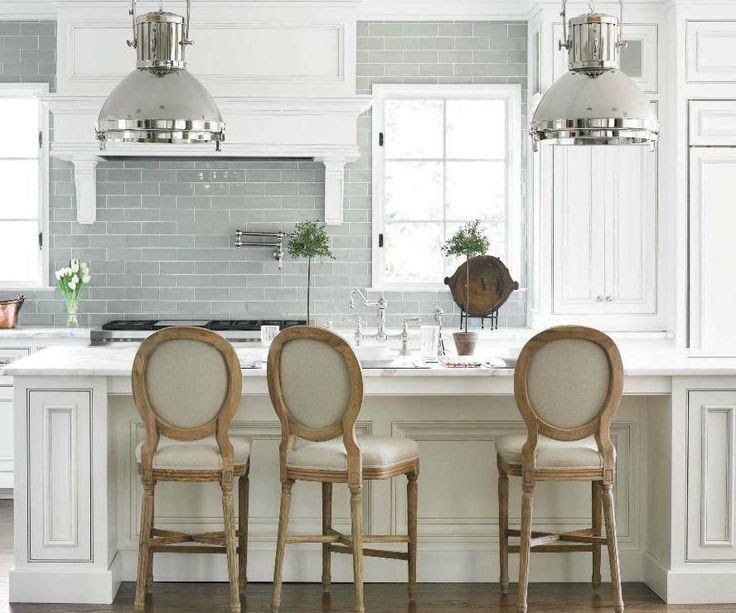 Stunning gray subway tile looks great with louis bar stools.