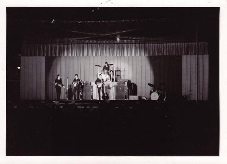 "Reader Dana Crick shared this memory and photo of the 1964 concert: ""In 1964 I was 12 years old and completely captivated by The Beatles. My step father, Paul Sunderland, who was 68 years old at the time, took me and my brother and sister to see the Beatles at Municipal Stadium. We had excellent ground level seats but, my clearest memory is that it was nearly impossible to hear the music over the screaming and shrieking of other young girls. Most members of the audience were standing on their seats, and being small for my age it was difficult to see. I did manage to shoot the two attached photographs with my Kodak Instamatic. In spite of the obstacles it was an absolute thrill to be in the presence of the The Beatles!"""