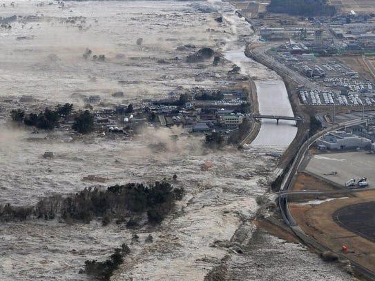 An earthquake-triggered tsunami sweeps shores along