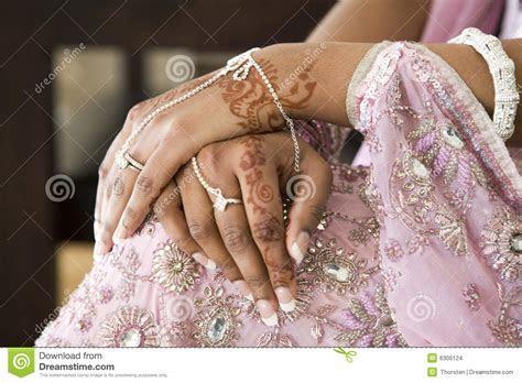 Bride's Hand With Henna Tattoo, Indian Wedding Stock Photo