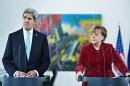 US Secretary of State John Kerry, left, and German Chancellor Angela Merkel, irght, address the media at the Chancellery in Berlin, Germany, Firday, Jan. 31, 2014. Kerry meets with members of the German government before attending the Munich Security Conference. (AP Photo/Brendan Smialowski, Pool)