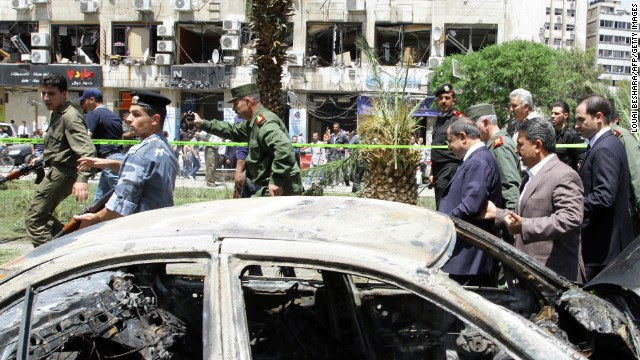 "Syrian Interior Minister Mohammed al-Shaar, third from right, visits the site of a blast in Damascus on Tuesday, April 30. The Syrian government said that at least 13 people died in what state-run TV described as a ""terrorist explosion."" Tensions in Syria first flared in March 2011, escalating into a civil war that still rages. This gallery contains the most compelling images taken since the start of the conflict."