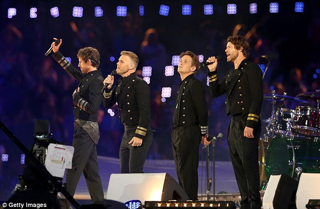 Stoic: Gary Barlow bravely appeared to perform with fellow members of Take That after the heartbreak of a losing baby Poppy at birth.