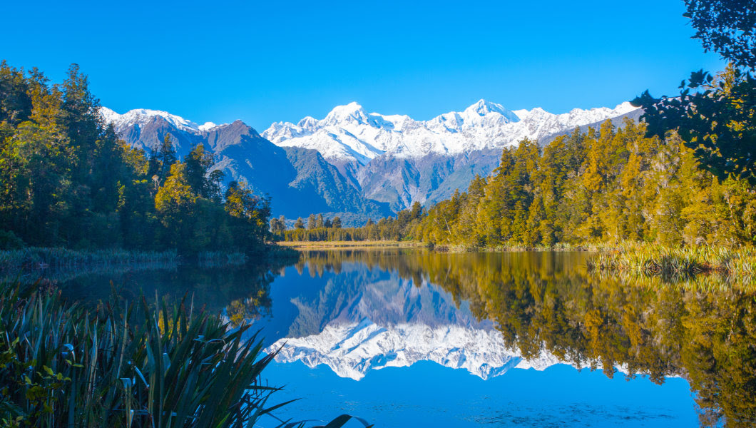Reflection of mountains in the lake Matheson, New Zealand