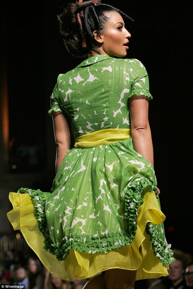 Dressed to frill: Kim was clad in a green and white dress with yellow underlay and sash for the show