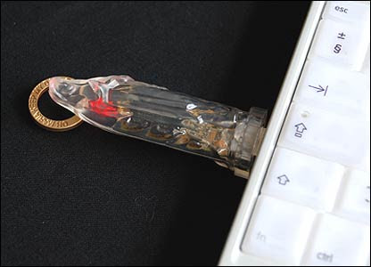 USB memory stick in the shape of Virgin Mary with flashing heart