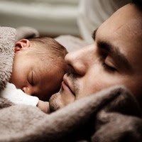 A father with his baby.