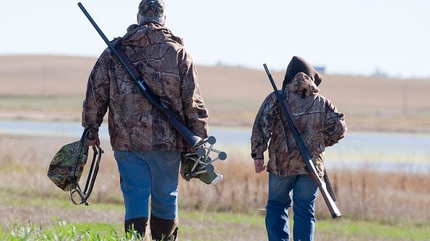 Grandpa and Grandson going duck hunting in North Dakota