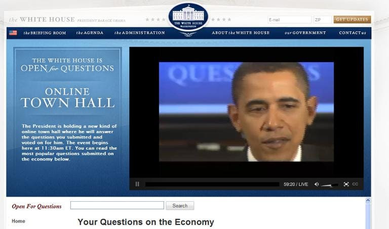 Barack Obama answers questions during an Internet town hall meeting on the economy in the East Room of the White House
