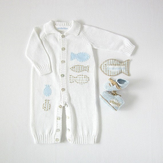 A knitted overalls in white full of fishes. Matching booties. - tenderblue