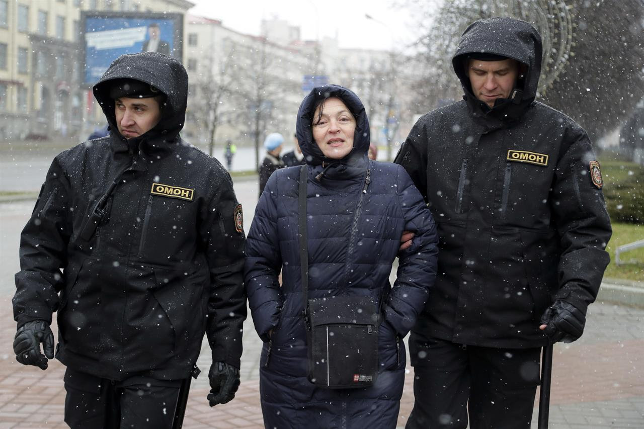 Belarus police detain a woman prior to an opposition rally in Minsk, Belarus, Saturday, March 25, 2017. Over the past two months, protests have broken out across the country of 9.5 million, sometimes attracting thousands — initially they were focused on the labor law but have grown to encompass calls for the resignation of President Alexander Lukashenko, whom critics call Europe's last dictator.