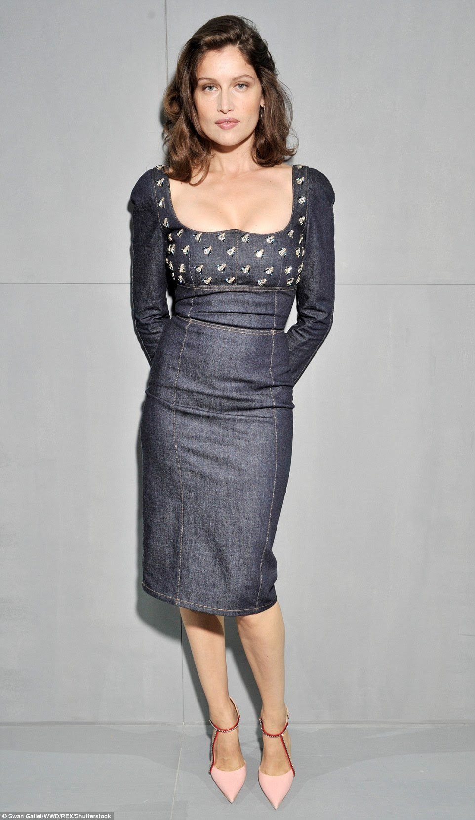 Denim delight: Laetitia Casta put on a busty display in a plunging knee-length Dior denim dress with a bee-embroidered decolletage