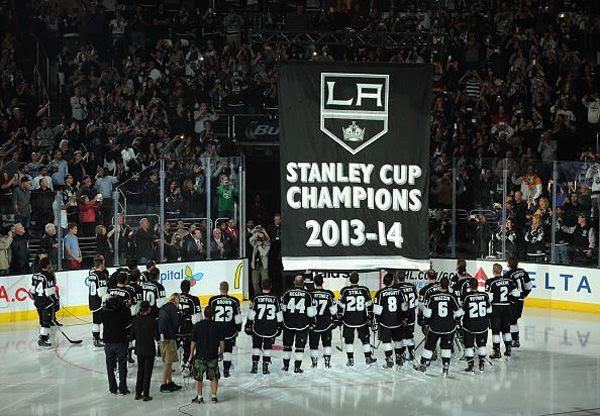The L.A. Kings and their fans watch as the 2014 Stanley Cup championship banner is raised towards the rafters at STAPLES Center, on October 8, 2014.