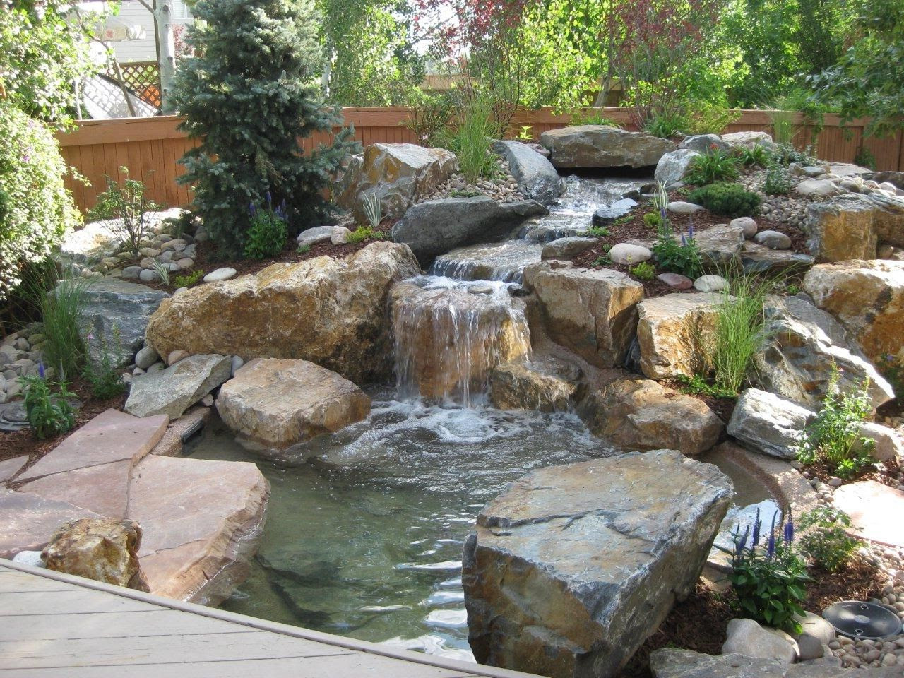 inspiring backyard water feature small pond grey rocks green plant decoration backyard water falls pool garden outdoor good design ideas of backyard water falls