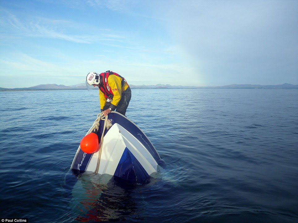 Brave: Paul Collins came second in the Royal National Lifeboat Institution photography competition with this picture showing an up tuned boat in Abersoch, Wales