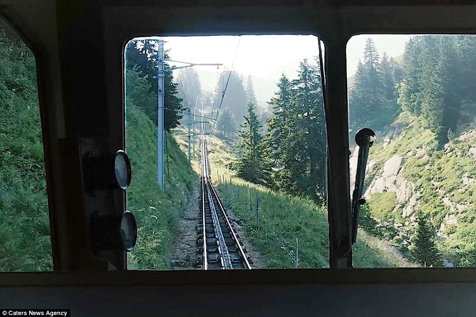 Mr Sanchagrin said: 'The train is very quiet but just a little creaky, but the ride provides a stunning view of Lake Lucerne'