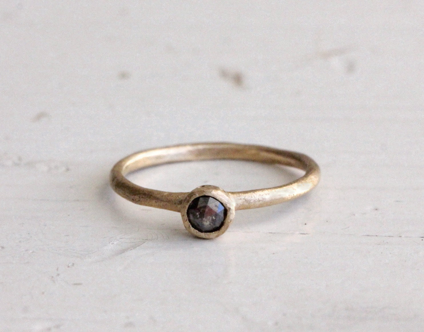 A dark charcoal diamond ring. Rose cut. Engagement. Faded black diamond. Patch