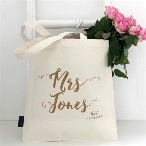 'mrs' personalised wedding bag by kelly connor designs