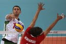 Bulgaria's Tsvetan Sokolov (L) spikes the ball against Poland's Michal Winiarski during their men's Group A volleyball match at the London 2012 Olympic Games at Earls Court