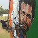 The Indian artist Ranjit Dahiya working on a mural of Sachin Tendulkar in Mumbai last week.