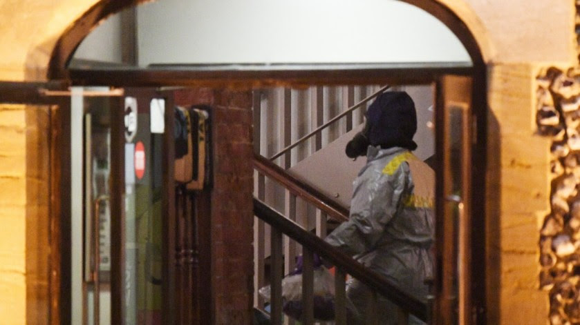 File Photo: Forensics search The Mill pub in Salisbury in Britain. EPA, FACUNDO ARRIZABALAGA