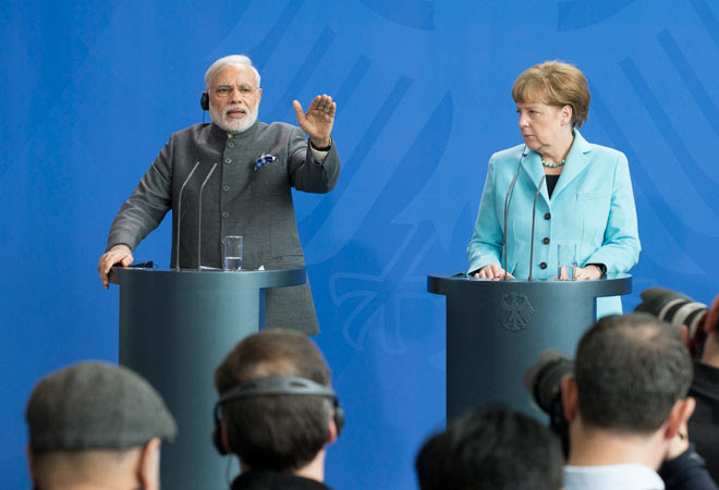 German Chancellor Angela Merkel and PM Narendra Modi attend a news conference after their talks in the Chancellery in Berlin on April 14, 2015.