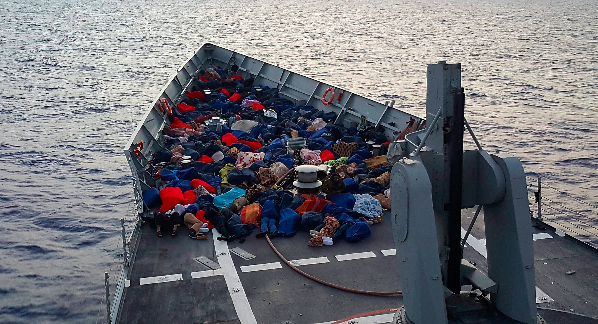 epa05349409 An undated handout picture made available on 07 June 2016 by the Spanish Army shows migrants after being rescued by Spanish frigate 'Reina Sofia' (Queen Sofia) at sea near Italian coasts, during the Operation 'Sophia', a European Union Naval Force's (EUNAVFOR) mission to prevent loss of life at sea in the Mediterranean Sea.  EPA/SPANISH ARMY  HANDOUT EDITORIAL USE ONLY/NO SALES