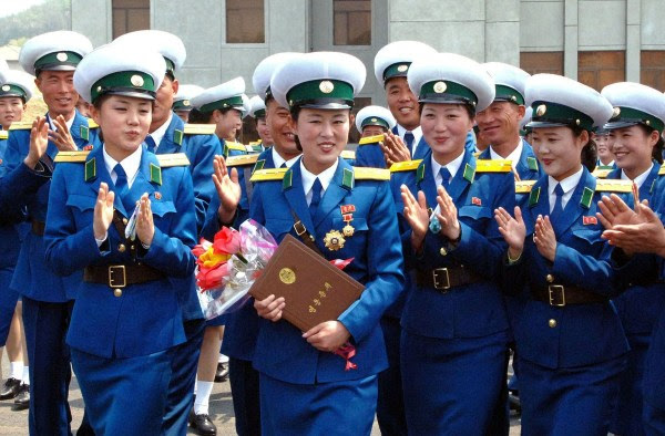 """Pyongyang, North Korea, female traffic officer Ri Kyong Sim awarded the rare """"Hero of the Republic"""" honor for protecting a senior government official."""