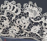Irish crochet lace, late 19th century. The design of this example is closely based on Flemish needle lace of the 17th century.