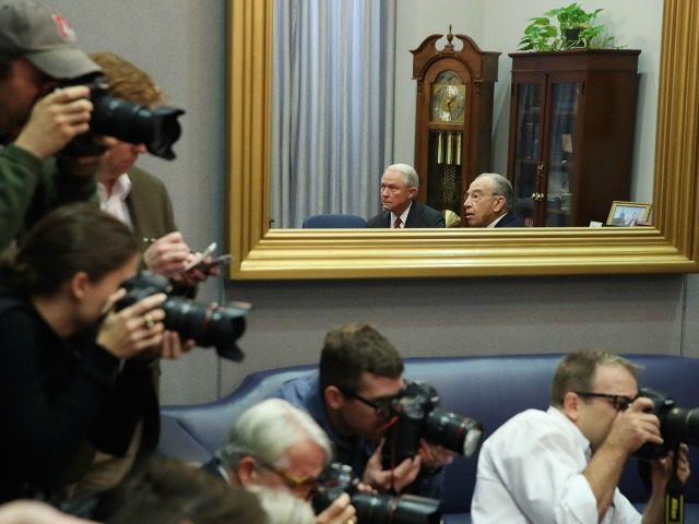 WASHINGTON, DC - NOVEMBER 29: Members of the media gather to photograph U.S. Attorney General nominee Sen. Jeff Sessions (R-AL) (L) and Senate Judiciary Committee Chairman Chuck Grassley (R-IA), who are reflected in a mirror during a meeting on Capitol Hill, November 29, 2016 in Washington, DC. President-elect Donald Trump and his transition team are in the process of filling cabinet and other high level positions for the new administration. (Photo by )