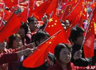 Chinese people wave national flags
