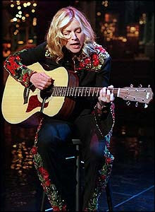 Madonna with acoustic guitar