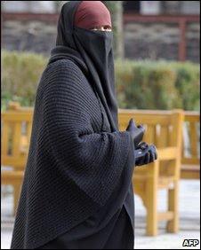 A woman wears a full-length veil in Lyon, 25 January