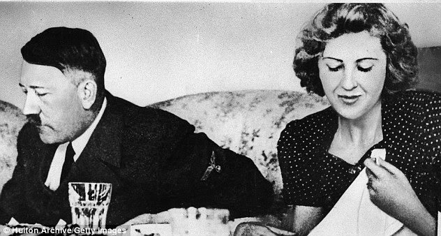 Eating: Hitler with his mistress Eva Braun. Every meal the dictator had was tasted to make sure he was not poisoned