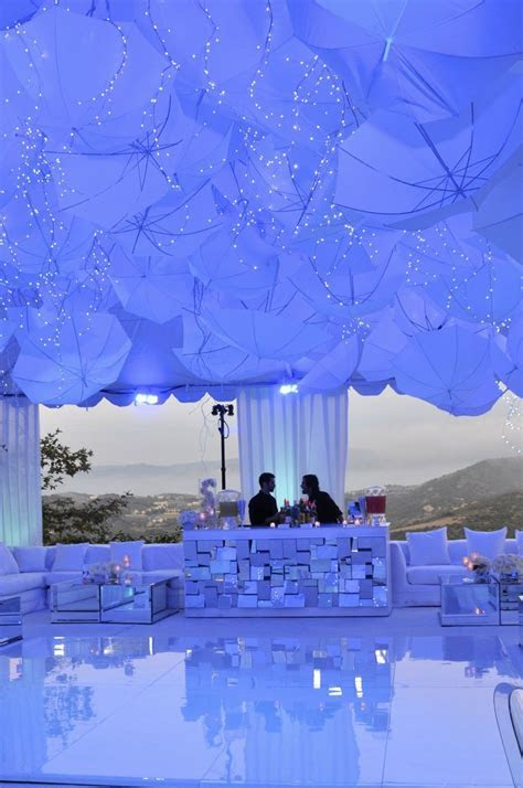 umbrellas with string light awesomeness   Wedding Ceiling