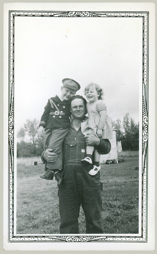 Man and two children