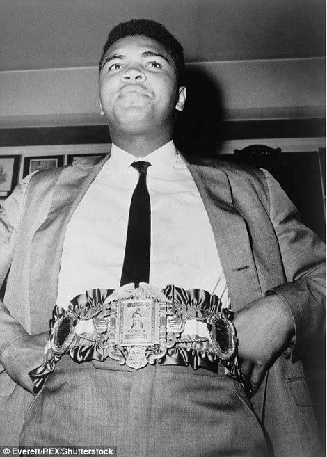 Posing after winningthe 24-carat gold-plated heavyweight championship belt on September 18 1964