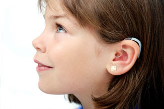 girl with hearing aid